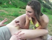 Amazing ballbusting bikini babe defends herself against an attacker