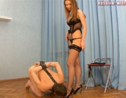 Slave used to kissing the floor under domina's feet gets to taste her toes
