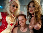Two smoking hot latex clad evil nurses use a piece of man meat to painfully drain every ounce of man...
