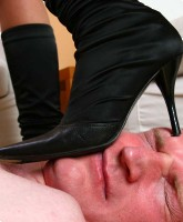 Exceptionally loud slave gets tape-gagged and trampled as a prelude before being forced to lick his ...