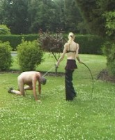 Mistress letting her slave out in the garden