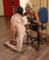 Skillful ripe domina tortures her slave's sack till it gets dark and shiny